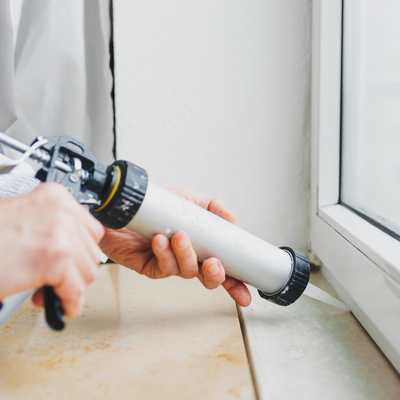 sealing window with caulk to prevent bugs from entering